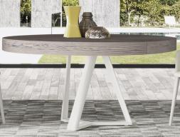 Table ronde  extensible et piétement laqué ou en acier inox. Mod. CROSED