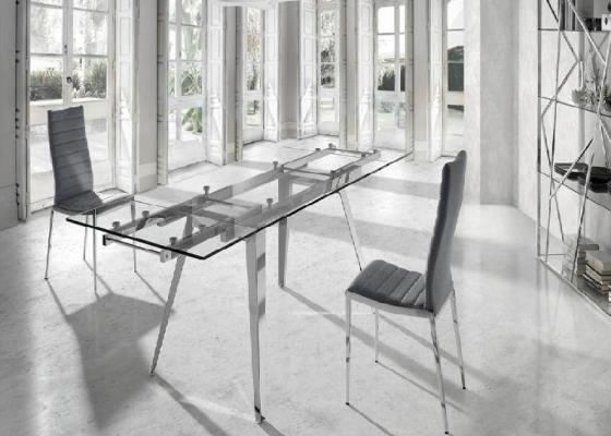 Table à manger extensible avec pieds en acier et plateau en verre. Mod. LOTUS