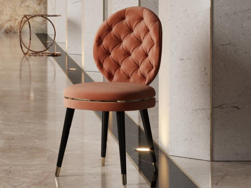 Chaise design tapiss�e avec capitonn�. Mod. EVA