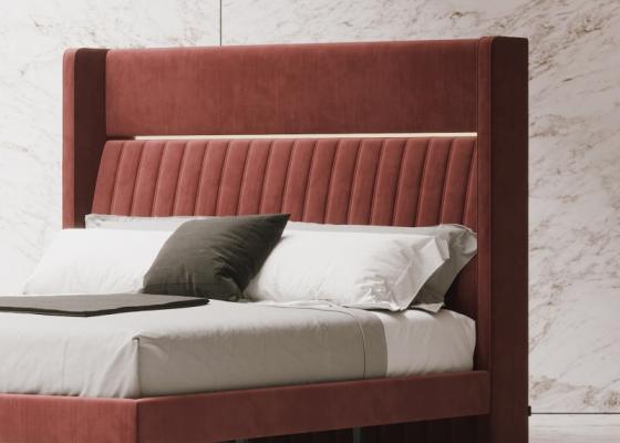 Tête de lit tapissée avec détails en acier inox. Mod. CAMILE