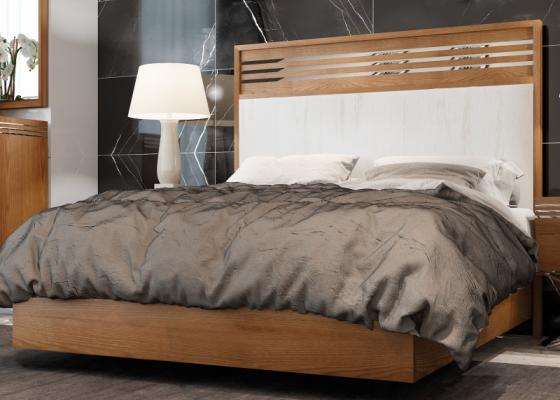 Lit complet en bois de noyer avec tête de lit tapissée. Mod. ACIER