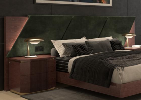Longue t�te de lit rapiss�e en bois de noyer. Mod. PRASSEDE