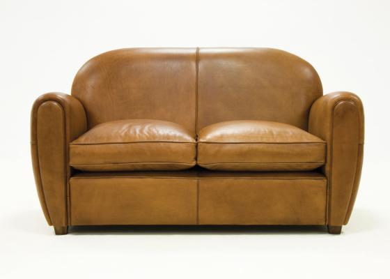 Canapé tapissé en cuir véritable. Mod. ROYAL