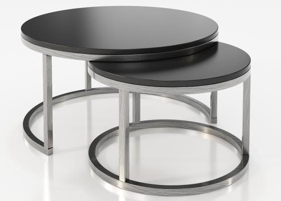 Ensemble de deux tables rondes gigognes avec plateaux laqués.Mod: ADIL