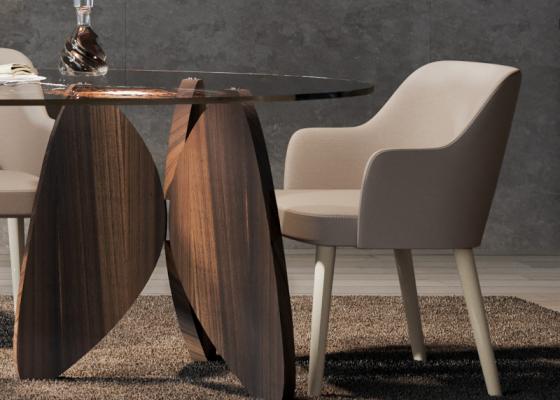 Chaise tapissée avec piétement en bois de noyer. Mod. OLSO