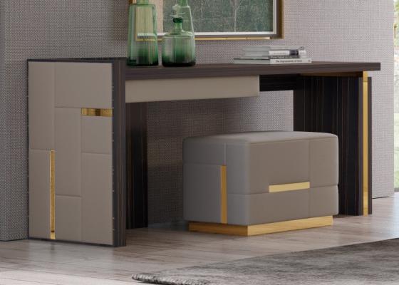 Bureau en bois d'ébène avec les cotés tapissés et décorations en acier inox. Mod. SALMA